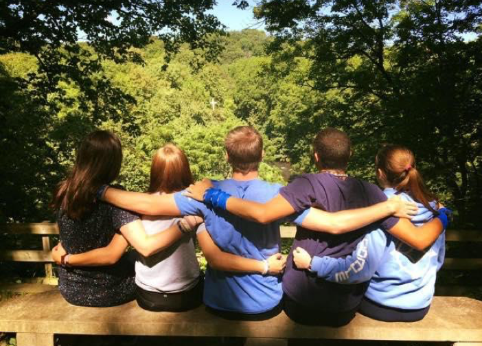 friends hugging looking into nature