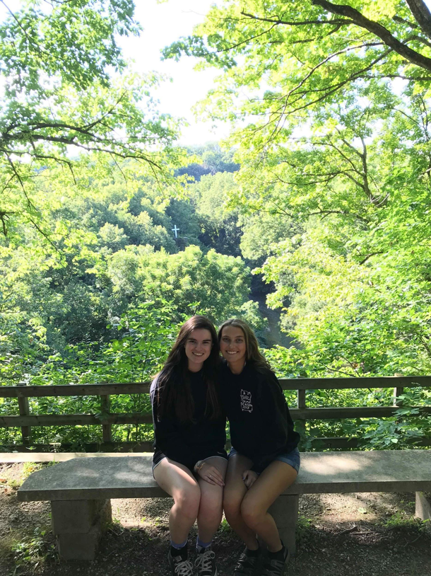 girls sitting on a bench at Camp
