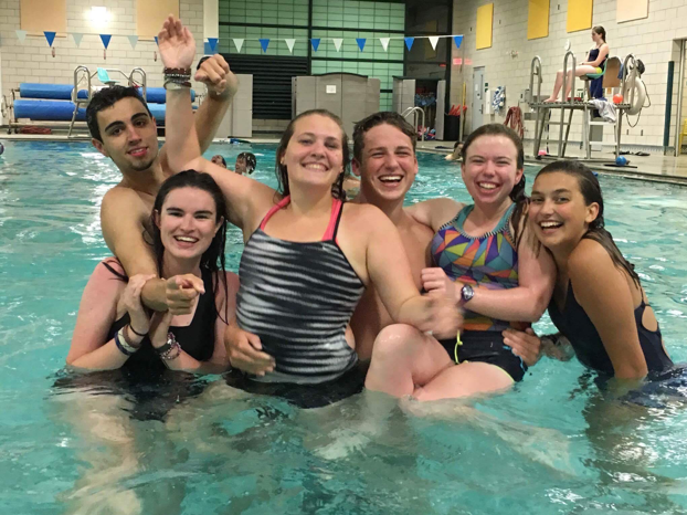 friends in a swimming pool at Camp