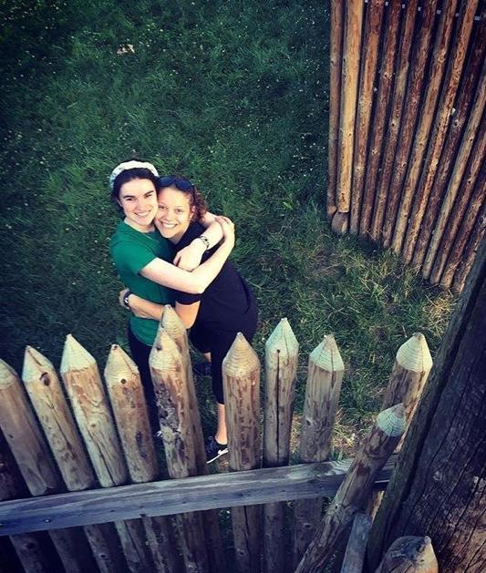 friends hugging at Camp