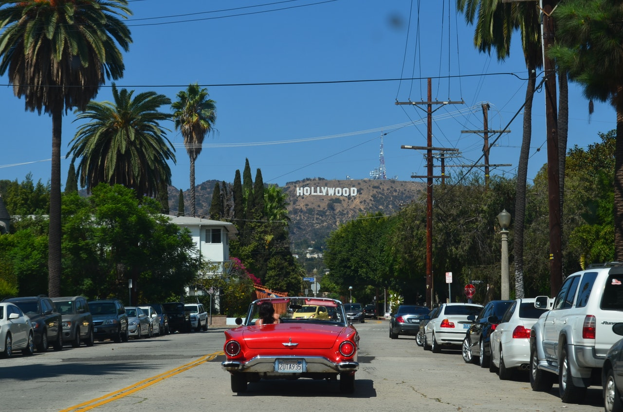 American Classic car at Hollywood sign