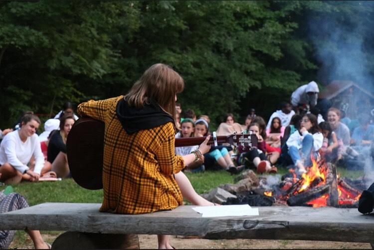 Playing guitar at summer camp