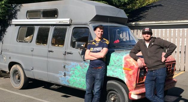 Men with camper van in Canada