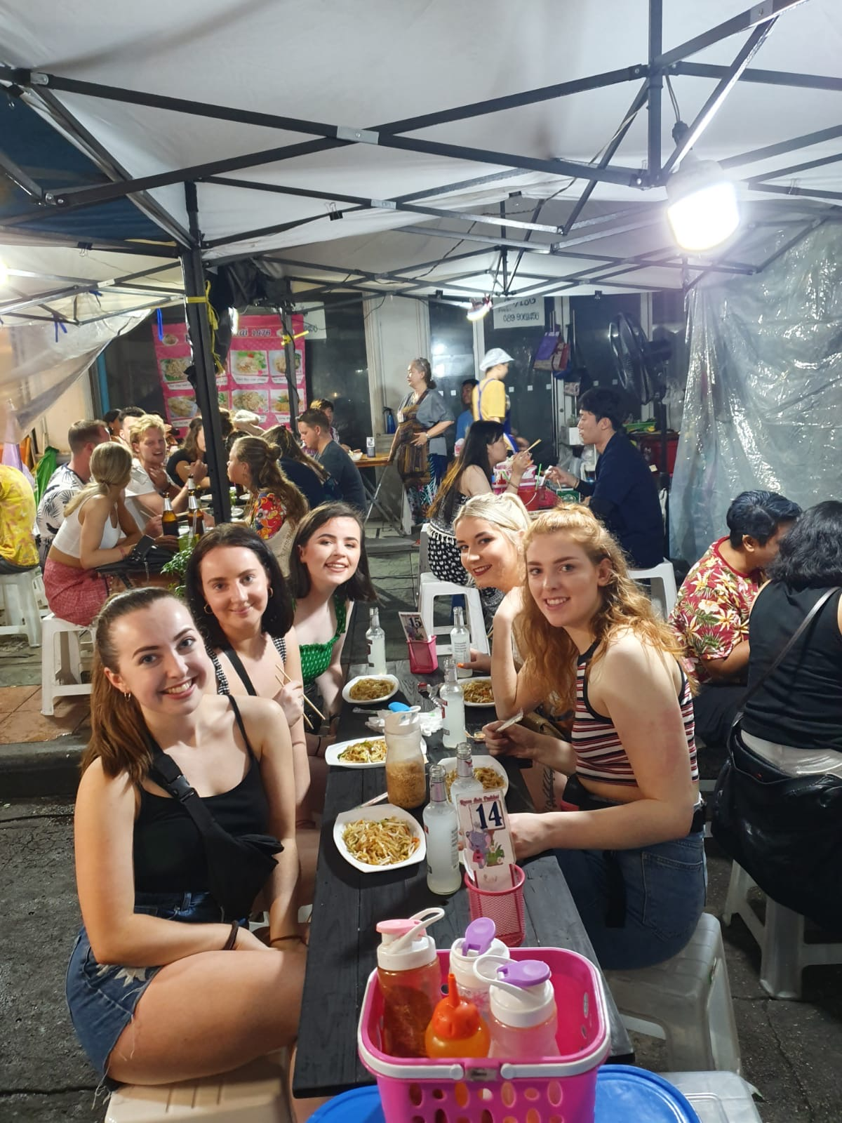 girls eating street food in Thailand