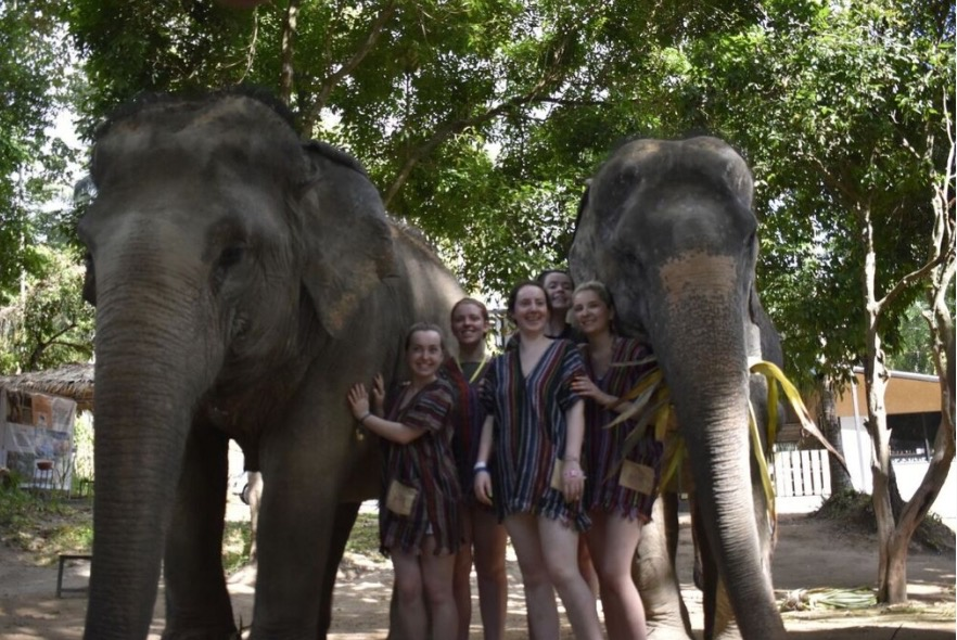 girls with elephants in Thailand