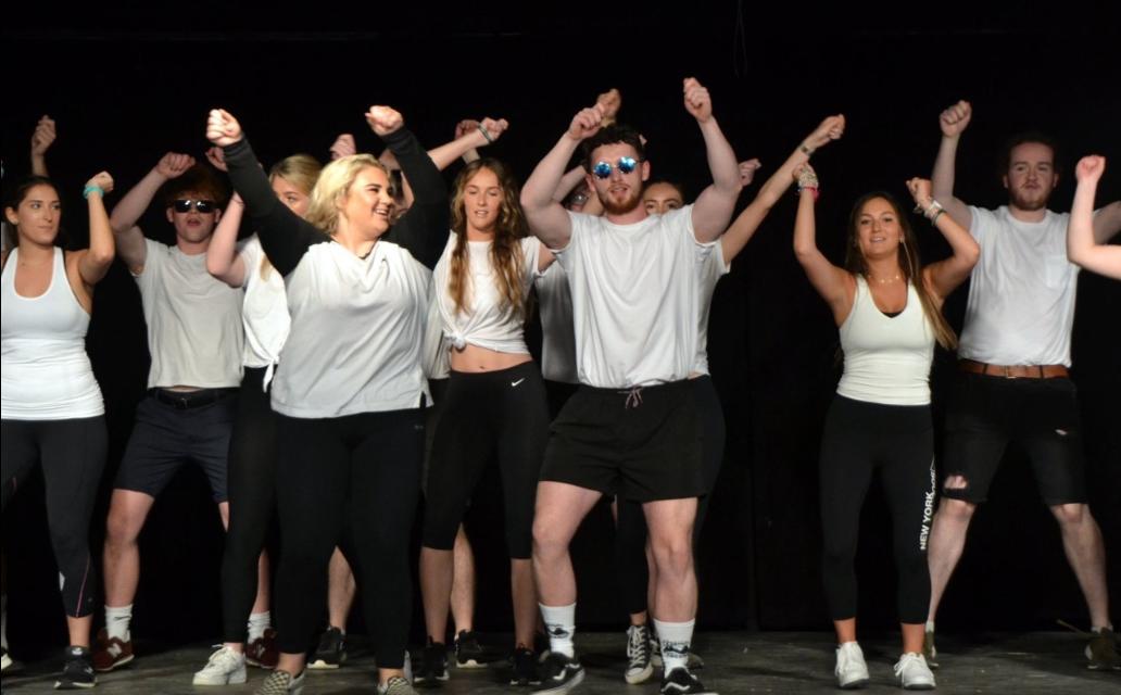 camp counsellors performing at camp USA